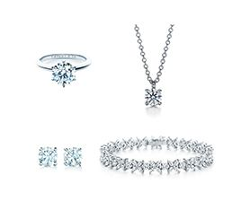 A diamond necklace and diamond earrings - what we pawn