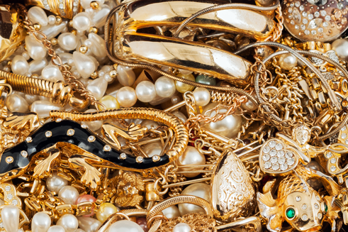 A pile of various gold jewelries - cash for gold jewelry store
