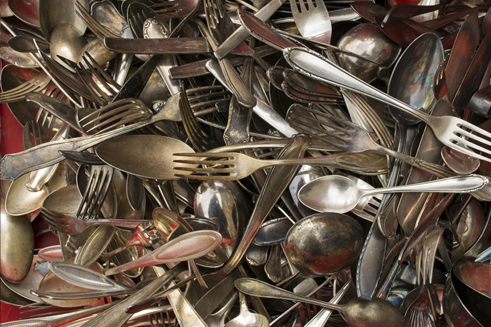 A shot of various sterling silverware utensils - sterling silver flatware