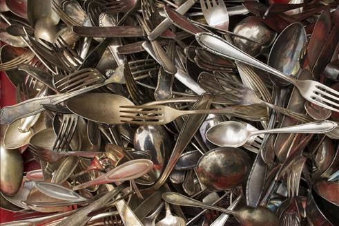 A shot of various sterling silverware utensils - sterling silver flatware