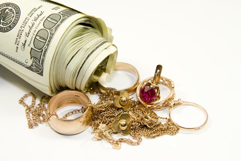 Roll of cash with rings and jewelry - how pawn loans work